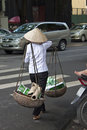 Vietnamese woman carries old paper and plastic hanoi august on august in hanoi vietnam hanoi has an estimated population of Stock Photography
