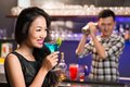 Vietnamese woman with a drink women drinking cocktail in the bar Stock Photo