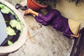 A Vietnamese woman takes an afternoon nap under the popular coni Royalty Free Stock Photo