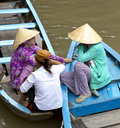 Vietnamese women on the Mekong River Stock Photo