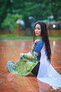 Vietnamese women wear ao dai in the rain woman holding umbrella is famous traditional custume for woman vietnam Stock Photo