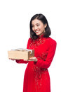 Vietnamese young woman in Ao Dai dress holding gift box. Royalty Free Stock Photo