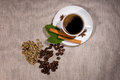 View from above of beans with hot coffee inside Royalty Free Stock Photo
