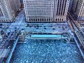View from above of ice chunks on a blue colored Chicago River. Royalty Free Stock Photo