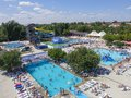 View from above on outdoors swimming pools in water park. Royalty Free Stock Photo