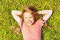View from above of smiling girl laying on  grass Royalty Free Stock Photo