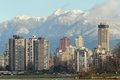 View across english bay apartments condominiums west end snow capped north shore mountains vancouver british columbia canada Royalty Free Stock Image