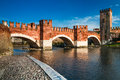 View of adige river and medieval stone bridge of ponte scaligero in verona built in th century near castelvecchio italy Stock Photos