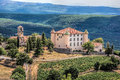 View Of Aiguines Village And Renaissance-style Chateau with mountains in Provence, France Royalty Free Stock Photo