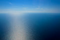 View from airplane window. The sea and the sky Royalty Free Stock Photo