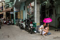 View of an alley in ho chi minh city district phu nhuan vietnam motorbikes are parked one after another the right the Stock Photography