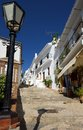 View along steep stepped village shopping street frigiliana malaga province andalucia spain western europe Royalty Free Stock Images