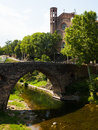 View of ancient church and bridge in sant joan les fonts medieval built with volcanic stone catalonia spain Royalty Free Stock Photo