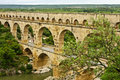 View ancient roman aqueduct called pont du gard Stock Photos