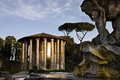 View of ancient temple and fountain tritons ercole in front the bocca della verità in rome italy Stock Photo