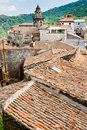 View on ancient tile roofs and church tower Royalty Free Stock Photo