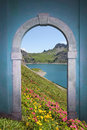 View through arched door; alpine lake and mountains Royalty Free Stock Photo