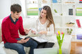 View of an Attractive couple doing administrative paperwork Royalty Free Stock Photo