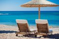 View of the beach with chairs and umbrellas greece Royalty Free Stock Photography