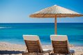 View of the beach with chairs and umbrellas greece Stock Image