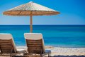 View of the beach with chairs and umbrellas greece Royalty Free Stock Image