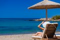 View of the beach with chairs and umbrellas greece Royalty Free Stock Photos