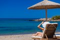 View of the beach with chairs and umbrellas greece Stock Photo