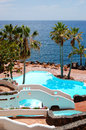 View on the beach, palms and swimming pool of luxury hotel Royalty Free Stock Photography