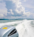 View behind the speed boat on sea in sunny day Royalty Free Stock Photo