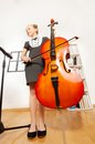 View from below of girl playing violoncello Royalty Free Stock Photo