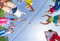 View from below of kids playing volleyball Royalty Free Stock Photo