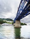 View from below of the lower part of a railway iron bridge that Royalty Free Stock Photo