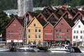 View of bergen tourists and locals stroll along the unesco world heritage site bryggen july in is the second largest city in Royalty Free Stock Photos