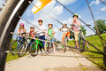 View from bicycle spoke on kids with helmets Royalty Free Stock Photo