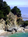 View of Big Sur California Cove with waterfall in Julia Pfeiffer Burns State Park. Royalty Free Stock Photo