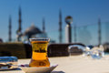 View of the Blue Mosque (Sultanahmet Camii) through a traditional turkish tea glass, Istanbul, Turkey Royalty Free Stock Photo