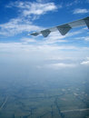 View of blue sky with jet plane wing Royalty Free Stock Photo