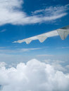 View of blue sky and jet plane wing Royalty Free Stock Photo