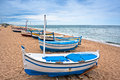 View of a boat in on a beach in Calella, Spain Stock Photos