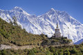 View of a Buddhist stupa with mountain Lhotse and Ama Dablam behind on the way from Namche Bazaar to Tengboche. Royalty Free Stock Photo