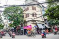 View of busy traffic with motorbikes and vehicles in Hanoi Old Quarter, capital of Vietnam. Royalty Free Stock Photo