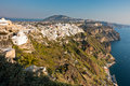 View of Caldera volcanic cliff at sunset, Fira, Santorini island Royalty Free Stock Photo