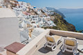 View of Caldera volcanic cliff at sunset, village of Oia, Santorini island Royalty Free Stock Photo