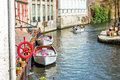 View on canal in brugge belgium and excursion boats Stock Image