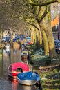 View on the canals in enkhuizen in the netherlands with colorful small boats afternoon sun Royalty Free Stock Photos