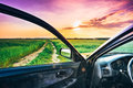 View from car window dirty rural road in field meadow countryside freedom and dream concept Stock Image