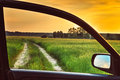View from car window dirty rural road in spring summer field meadow countryside freedom and dream concept Stock Photos