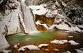View of Casoca waterfall in winter, Buzau, Romania