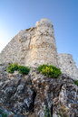 View of the castle from the bottom up ancient ruined at base cliffs Stock Image