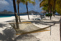 View of casuarina beach on palm island saint vincent and the grenadines hammock with sun loungers pagoda hobby cats tree shadows Royalty Free Stock Photography
